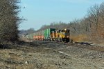 UP 8501 Heads up hill with a stack in tow.
