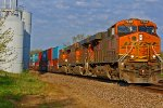BNSF 7868 Leads a EB stack train in Morning light.