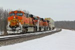 BNSF 7675 Leads Wb stack train.