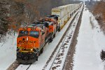 BNSF 7298 Heads Down Hill With a stack.
