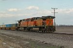 BNSF 5615 coal power on a stack train.