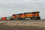 BNSF 5438 and Bnsf 7014 shove hard on a Wb stack train.