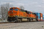 BNSF 7303 Works hard on a stack train.