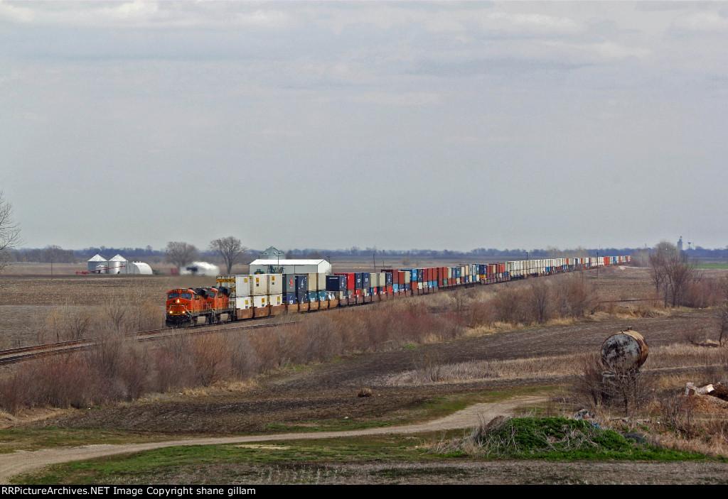 BNSF 7239 Rips a Wb stack train Across the Missouri Farm Fields.