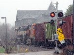 130503006 Westbound BNSF manifest passes Wayzata Depot in heavy May snow