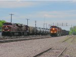 130613001 A CP tank train and BNSF manifest roll side by side at CTC University