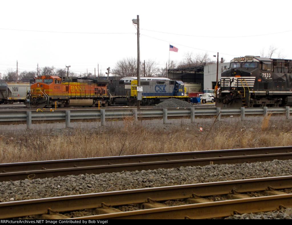 BNSF 4795, CSX 2735, and NS 7533