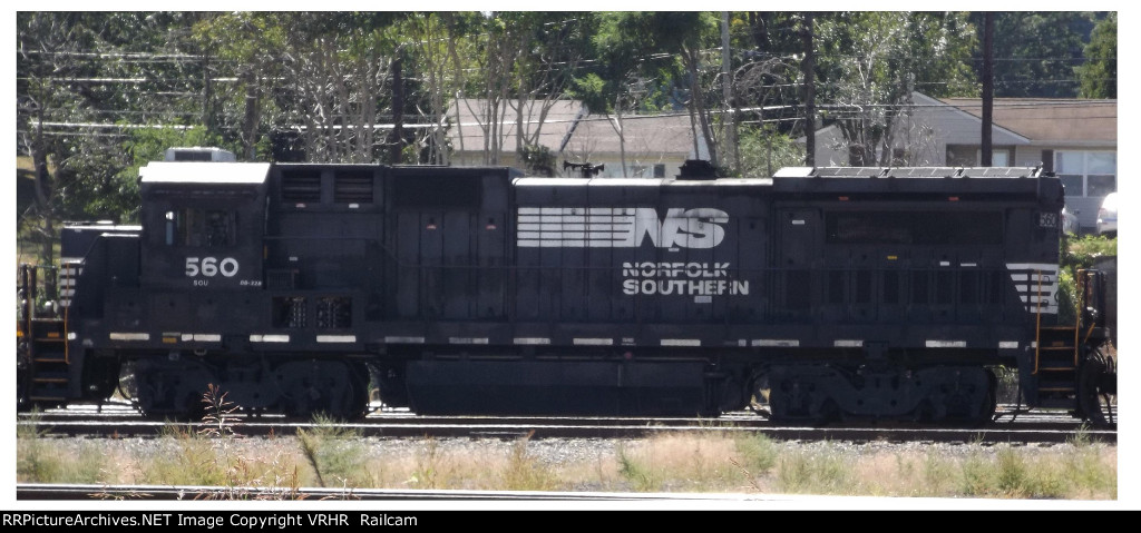 NS 560 sits idle in the yards with three other Dash-8's