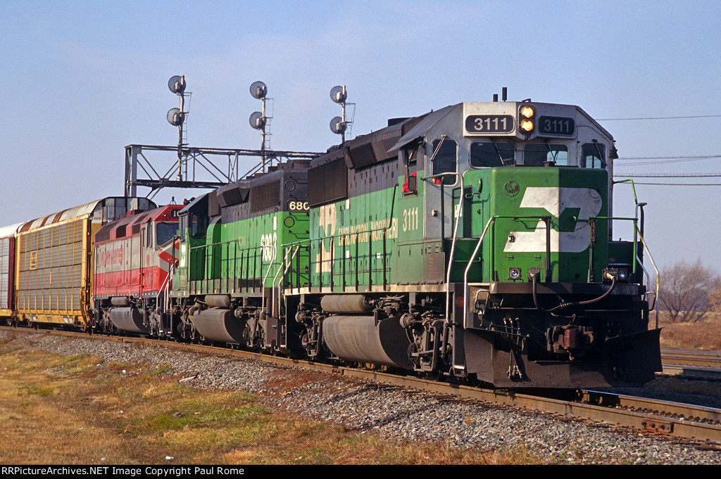 BN 3111, EMD GP50, leads an eastbound auto train with leased WSOR 1003 trailing