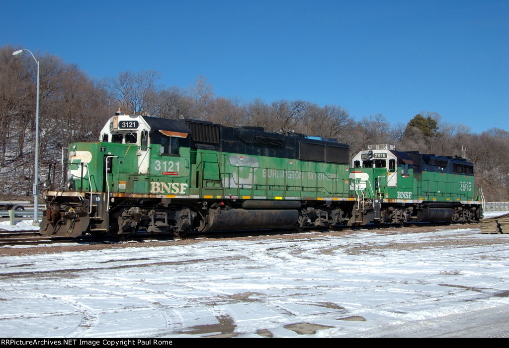 BNSF 3121, EMD GP50, and EMD GP39E BNSF 2915, at Gibson Yard