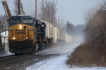 CSX Q010 kicks up snow!