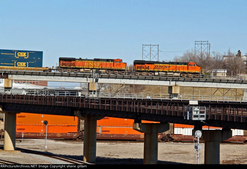 BNSF 7319 Runs Dpu on a stack train.
