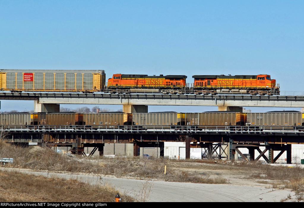 BNSF 7650 Takes a EB auto Past a EB coal load.