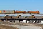 BNSF 7650 Takes a EB auto Past a EB coal load.