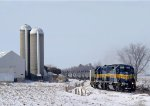 An Eastbound ICE Manifest Passes by a Couple Towering Silos