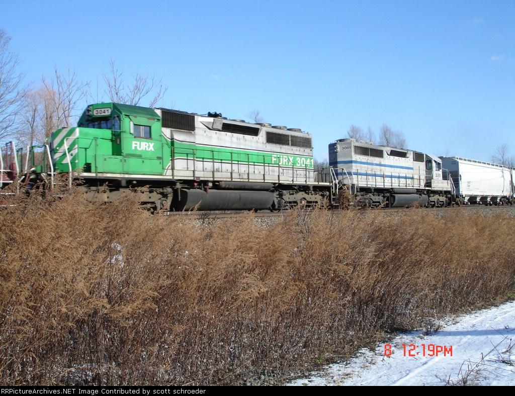 FURX 3041 & GCFX 3081 run WB with a CSX Freight in tow
