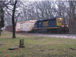 CSX 4034 sits beside the cemetary as D707 waits for a signal at Seymour