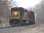 CSX 4024 rounds the curve at Seymour with D707-18 as snow starts to fall