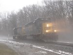 The headlights of the 4024 pierce through the fog as D707 waits for a signal back west onto Track 2