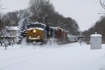 CSX 3027 bursts through built up snow at the Elliot St crossing after the previous night's 9 inch snowfall