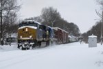 Covered in fresh snow, CSX 3027 & 7505 climb out of town with Q334-01