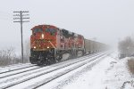With the rear of the train disappearing back into the snow, BNSF 9240 starts west with E945-15