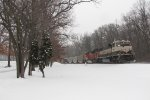 D801 heads away into the snowy landscape as it pushes N956 east