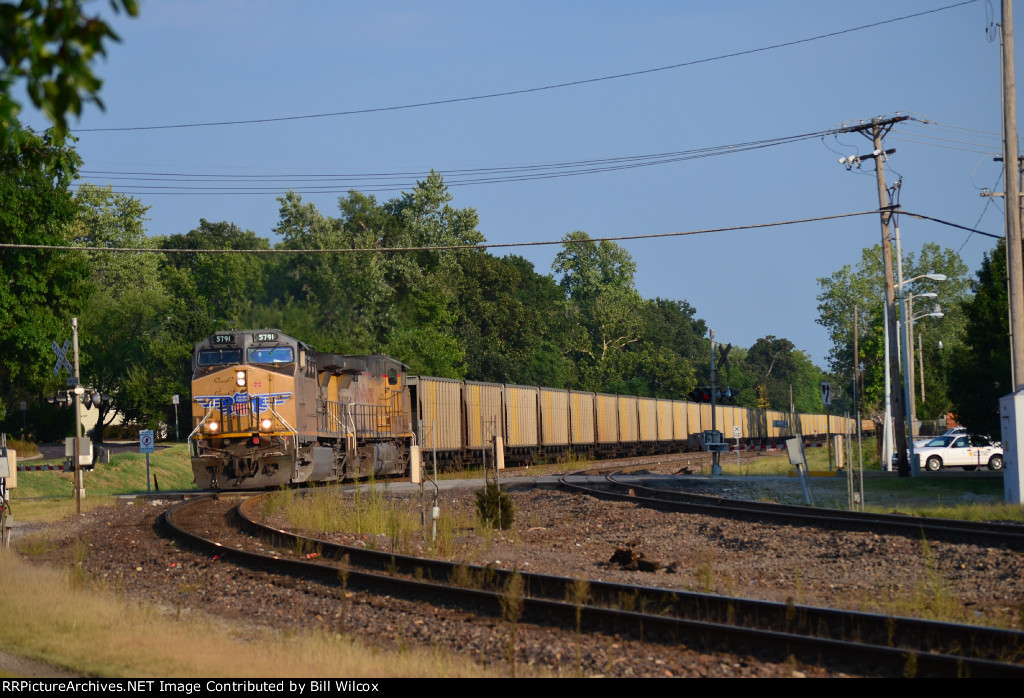 Westbound UP empy coal hoppers at South Taylor Avenue