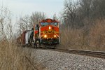 BNSF 5044 holds the main to let traffic clear ahead.