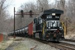 NS 8129 and empty oil train 65R