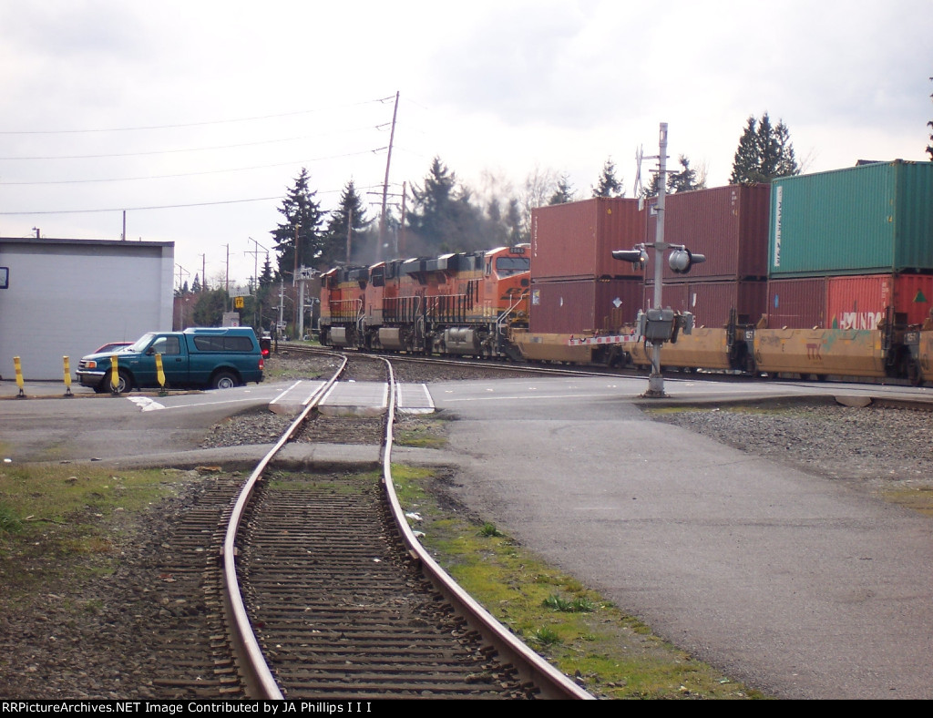 BNSF 4679-6829-6665 passing the Kent Gypsum spur with a southbound stack train