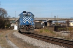 monster 72 car wood chip train runs to the end of the w line ready to head west bound thru town to NS Andrews yard
