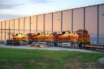BNSF 7117, BNSF 7118, and BNSF 7116 Gleem in the 07:10 am/CDT Texas Sunrise as they sit on the Northside track next to the Final Assmbly Building.