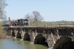 NS 8125 with NS 1071 slowing crossing bridge