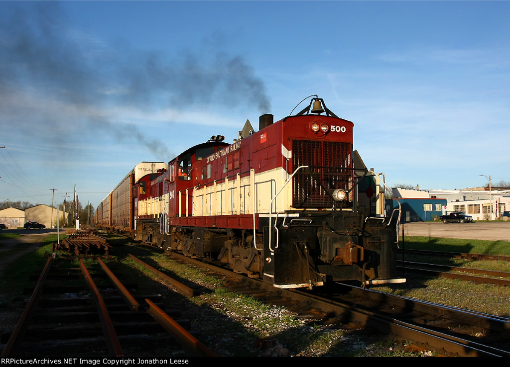 OSR 500 leads a train of autoracks off the CN interchange towards GM's CAMI assembly plant