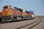 Westbound intermodal overtakes stack train