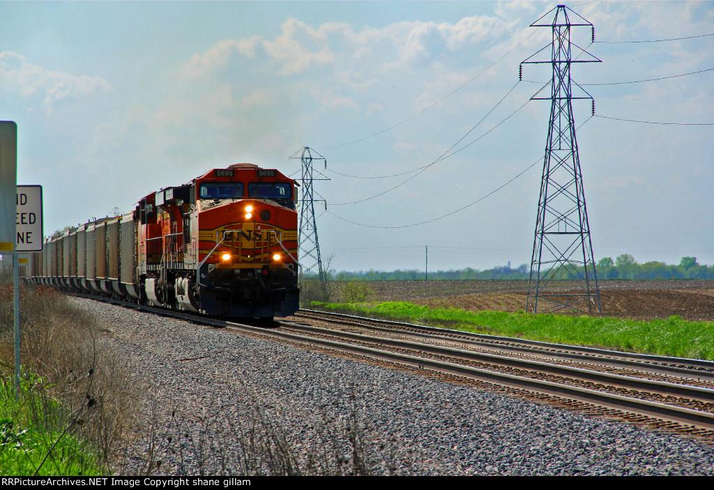 BNSF 5695 Takes a grain train EB,