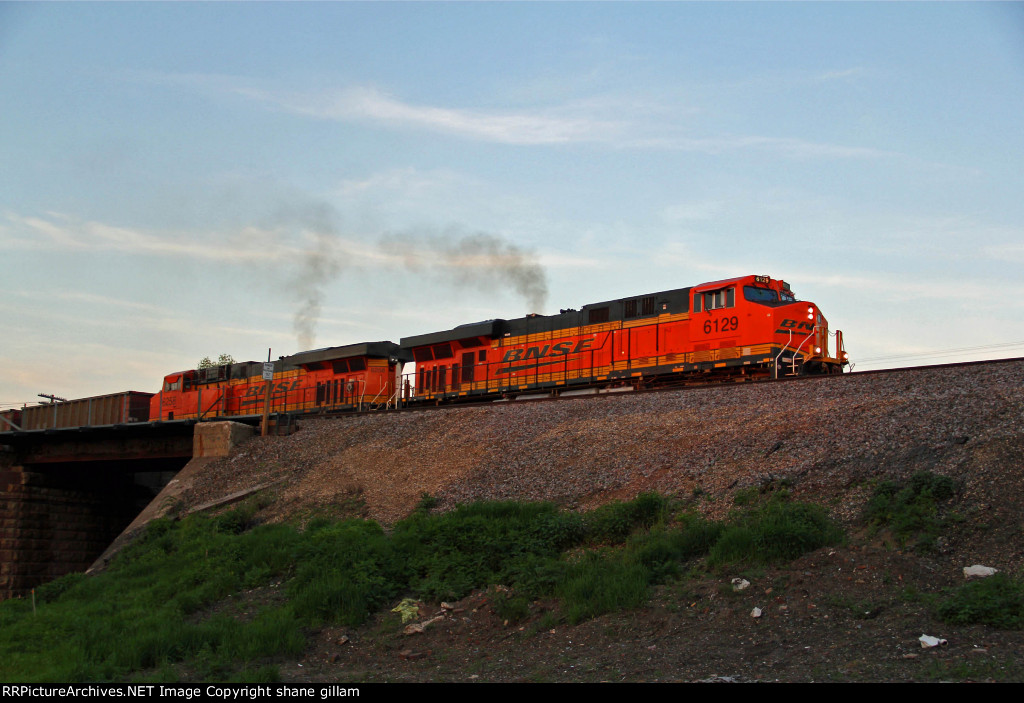 BNSF 6129 Leads a Wb coal empty into town.