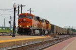 BNSF 6336 Leads a coal drag past the Amtrak Station.