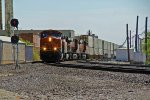 BNSF 7489 Slows for a crew change,