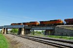 BNSF 4352 Eb grain train heads over the Bnsf outtuwa Line.