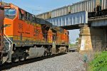 BNSF 4446 Runs EB with a grain train While a Wb grain passes over head.