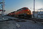 BNSF 4957 Heads Nb with a crude oil empty.