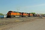 BNSF 5618 Heads up a Wb grain train out of town.