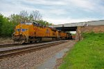 UP 7458 Leads a stack train Wb while a freight is over top.