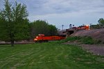 BNSF 7251 Heads Wb with stacks while a local returns above.