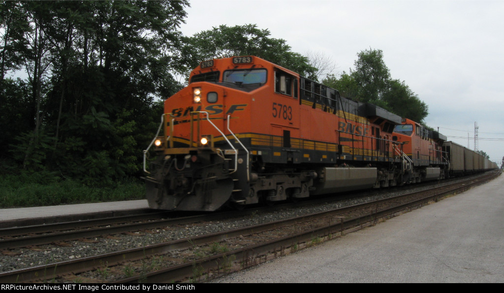 BNSF 5783 leads a west-bound CEFX loaded coal train.