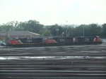 3 locomotives preparing to attach to train