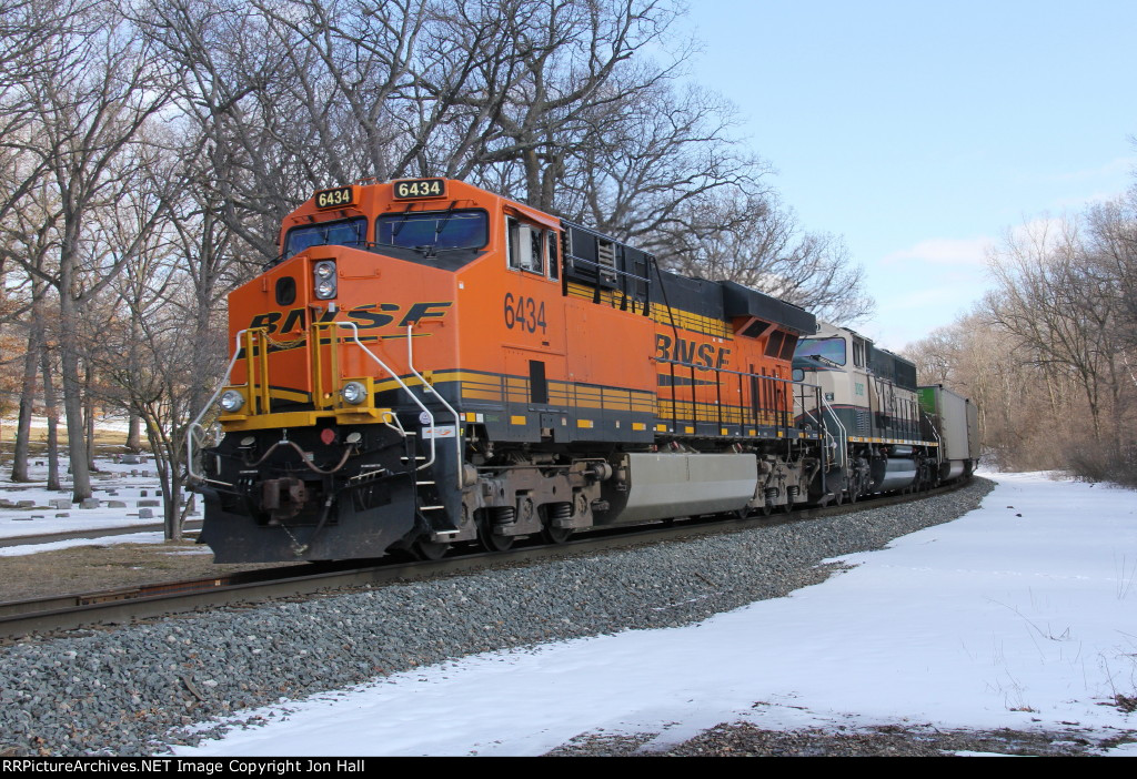 Just clear of Seymour, BNSF 6434 brings up the rear as D801 shoves N956 east out of town