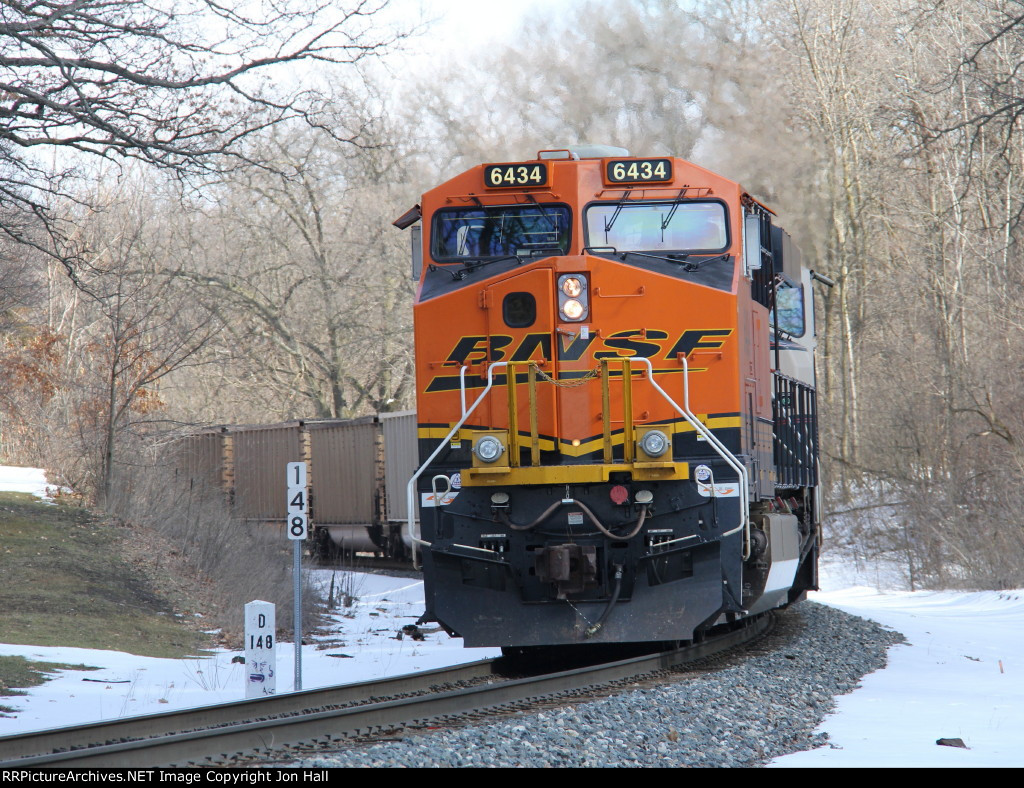 Down to about Notch 2 for a few moments, D801 rolls past milepost 148 while pushing N956 east